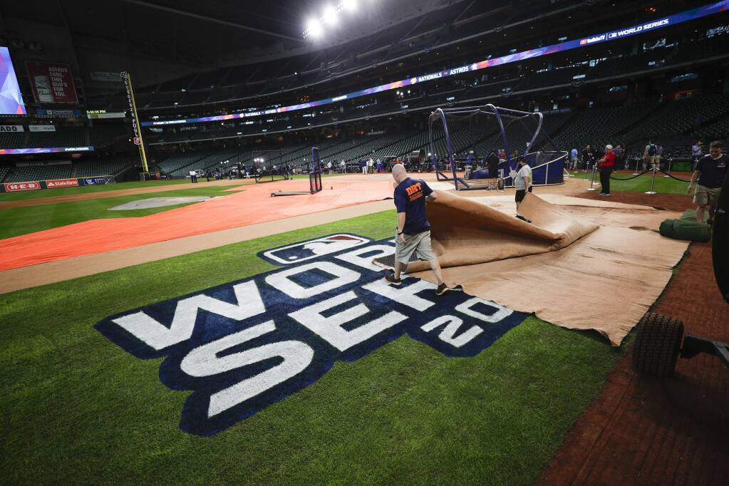 Members of the ground crew prepare the field during a practice day for baseball's World Series Monday, Oct. 21, 2019, in Houston. The Houston Astros face the Washington Nationals in Game 1 on Tuesday. (AP Photo/Eric Gay)