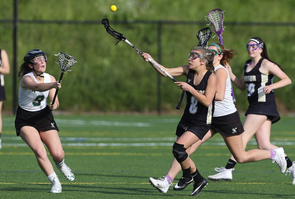 Windsor's Hailey Toste, right, and Sonoma Academy's Kate Roney go after a loose ball, during their lacrosse game in Santa Rosa on Tuesday, April 17, 2018. (Christopher Chung/ The Press Democrat)