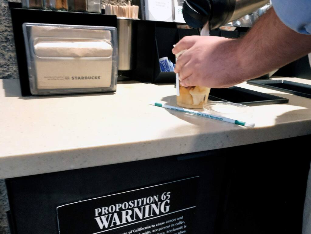The state is issuing new regulations that will drop a requirement for warning labels on coffee. (RICHARD VOGEL / Associated Press)