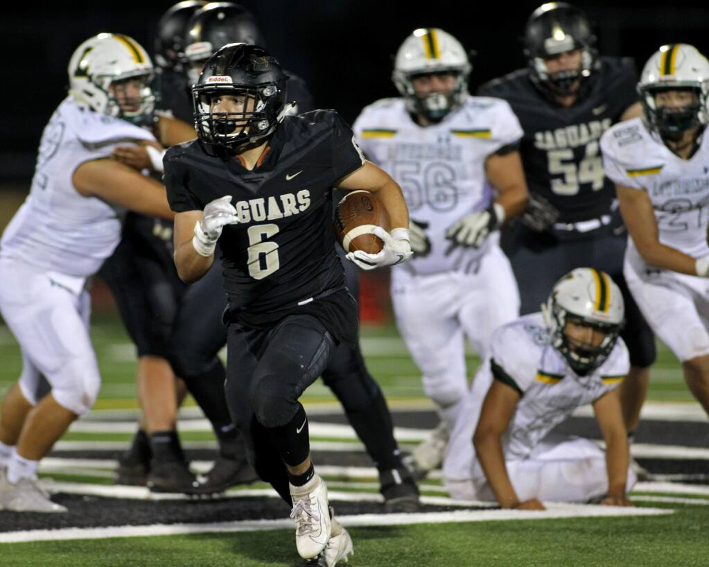 Windsor's Lorenzo Leon (6) breaks away for a touchdown run against Livermore in the first half of high school football at Windsor High School, on Friday, September 6, 2019. (Photo by Darryl Bush / For The Press Democrat)