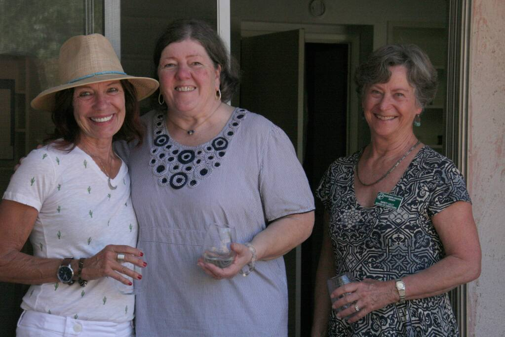 Kennedy Golden, younger daughter of M.F.K. Fisher, shares a laugh wiith Bouverie docent Sally Stone (left) and ACR board member Nancy Lilly on the porch of the Last House. (Christian Kallen/Index-Tribune)