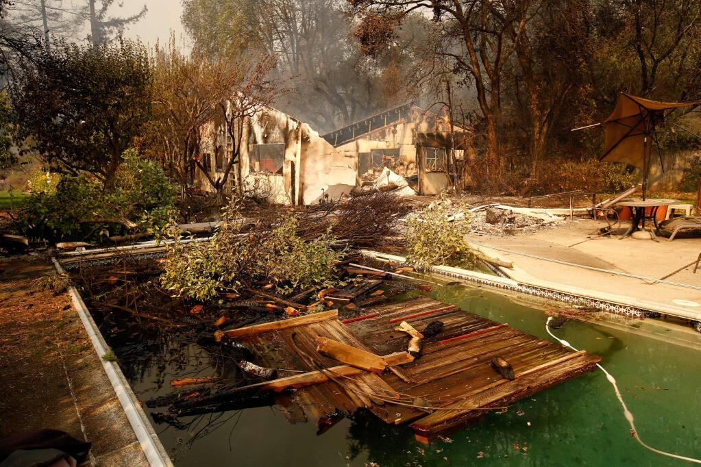 Damage in the backyard of a home off Deer Park Road after the Tubbs Fire burned through north Santa Rosa, California on Monday, October 9, 2017. (Alvin Jornada / The Press Democrat)