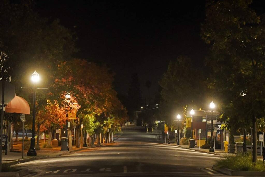 Empty streets in downtown Healdsburg Saturday evening just moments before the town went black after PG&E shut off power around 7:50 p.m. on Saturday, Oct. 26, 2019. (ERIK CASTRO/For The Press Democrat)