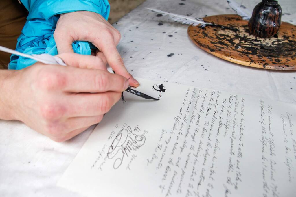 Visitors get passports and sign them with quill pens as they enter Petaluma Adobe State Park during Living History Day on Saturday, May 14, 2016. (ASHLEY COLLINGWOOD/FOR THE ARGUS-COURIER)