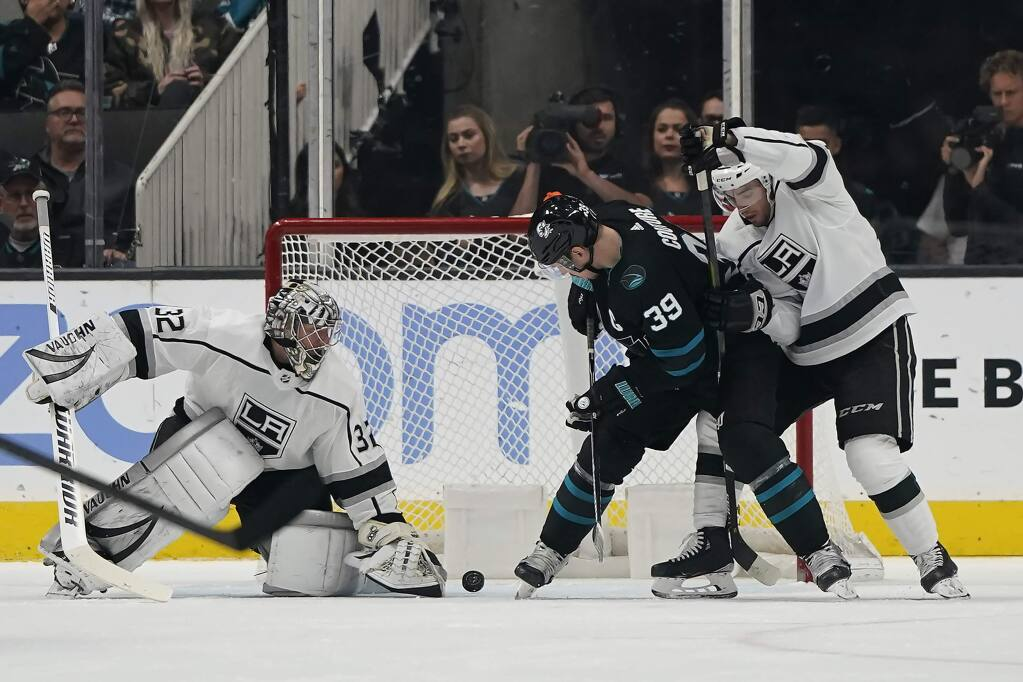 San Jose Sharks center Logan Couture, center, scores a goal past Los Angeles Kings goaltender Jonathan Quick during the second period in San Jose, Friday, Nov. 29, 2019. (AP Photo/Tony Avelar)