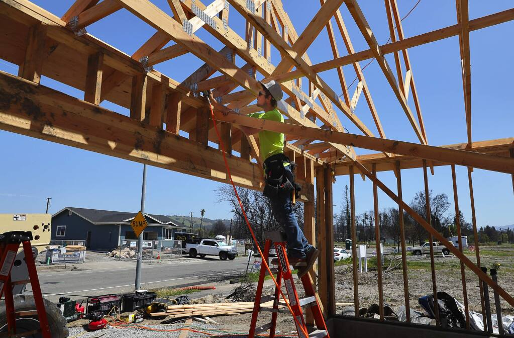 Josh Wilson works on framing a home along San Miguel Avenue in the Coffey Park area of Santa Rosa on Monday, April 23, 2018. (CHRISTOPHER CHUNG/ PD)