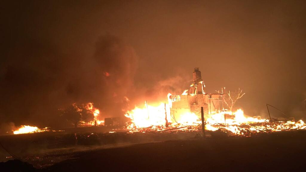 An unidentified structure burns in Kenwood shortly after midnight on Monday, Oct. 9, 2017. (KENT PORTER/PRESS DEMOCRAT)