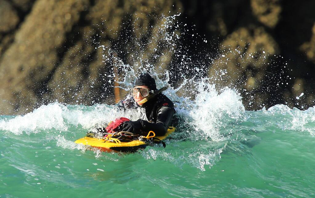 Patrick Reesink of Guerneville heads back in rough conditions with his limit of abalone at Ocean Cove on the last day of the season on Wednesday, November 30, 2016. (John Burgess/The Press Democrat)