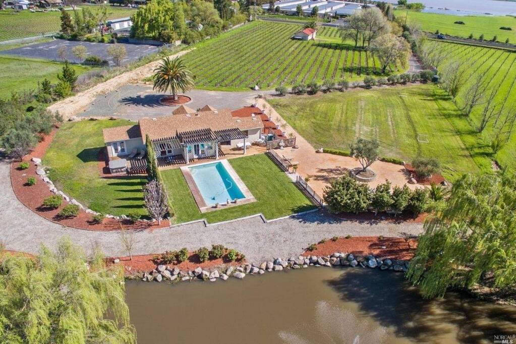 24321 Arnold Drive sits on a 4.5 acre lot with a hobby vineyard. Property listed by Heather Hanlon/Compass, compass.com, 707-529-2669. (Courtesy of BAREIS MLS)