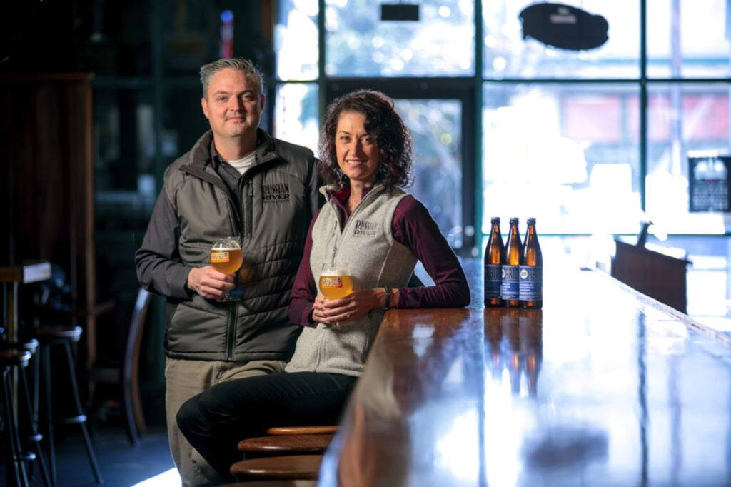 Natalie and Vinnie Cilurzo, of Russian River Brewing Company, at their brew pub in Santa Rosa in 2018 with Sonoma Pride beer they brewed to help Tubbs fire victims. (CHRIS HARDY)