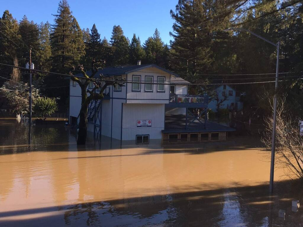 Flood water in Guerneville starts to recede on Mill Street leaving behind mud caked reminders of the level of the Russian River, Thursday, March 28, 2019. (Kent Porter / The Press Democrat) 2019