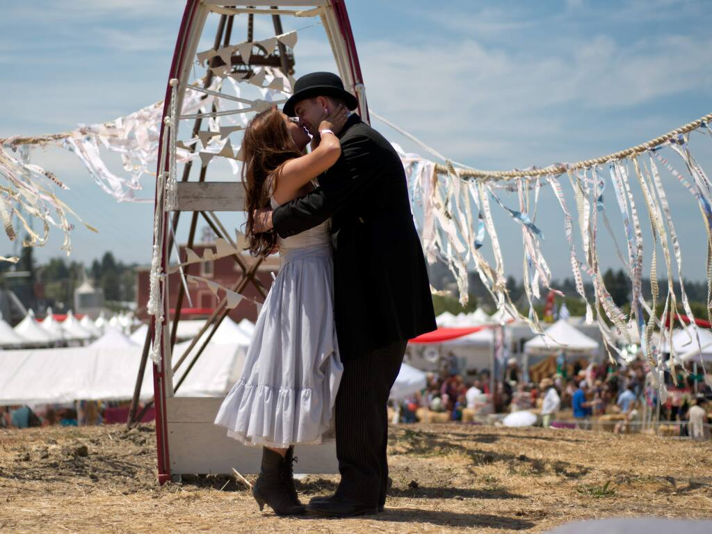 Newlyweds Jade and Michael Solis kiss after getting married at the Rivertown Revival in Petaluma, California, on July 19, 2014. (Alvin Jornada / For The Press Democrat)