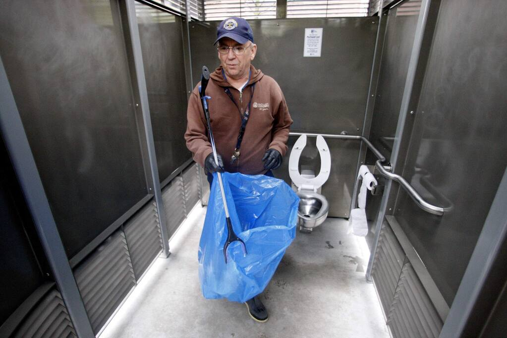 FILE - In this April 12, 2012, file photo, Rodney Haven, of Clean and Safe, cleans the interior of a Portland Loo in Portland, Ore. The city of Portland has intensified its efforts to market its patented Portland Loo, a solar-powered, 24-hour--a-day outdoor public restroom developed to give urbanites relief while warding off junkies, prostitutes and graffiti artists. The city has sold one loo to Victoria, British Columbia and hopes contracting with agents who get 10 percent of the sales will help it take in more cash. U-T San Diego reports that costs for two Portland Loos ballooned because they don't meet California electrical, seismic and other standards. They are being installed in downtown locations where connecting to sewer and water lines is difficult. San Diego anticipates spending $560,000, compared to an initial estimate of $215,000. (AP Photo/Rick Bowmer, File)