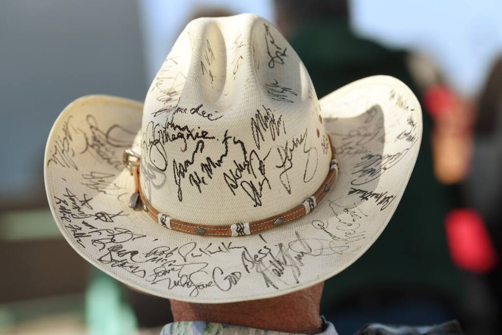 Jeff Bechler, of Petaluma, wearing a cowboy hat covered with autographs from bluegrass musicians, during RockSoberFest, an alcohol-free music festival, held Saturday at Sonoma-Marin Fairgrounds in Petaluma, California. September 28, 2019.(Photo: Erik Castro/for The Press Democrat)