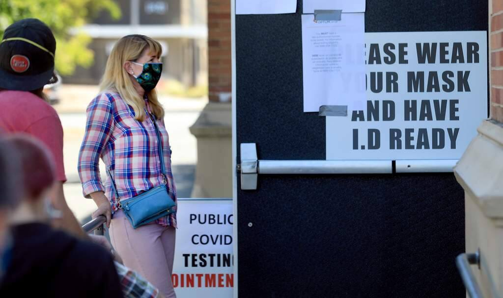 Tracy Ladd of Santa Rosa waits to get a coronavirus test, by appointment, Tuesday, May 5, 2020 at Santa Rosa High School. The testing was done through a company called OptumServe and is open to anyone from the general public. (Kent Porter / The Press Democrat)