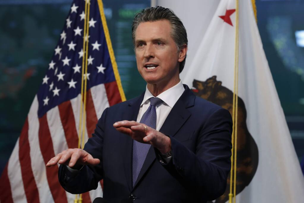 Gov. Gavin Newsom faces a grim new budget picture because of the coronavrius outbreak. (RICH PEDRONCELLI / Associated Press)