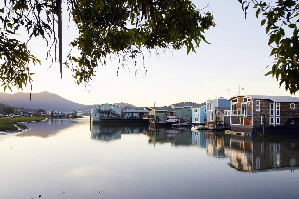 """FILE -- Houseboats in Sausalito, Calif., on April 16, 2019. Nestled in the scenic hills across the bay from San Francisco, Sausalito """"knowingly and intentionally"""" maintained racial segregation, the state attorney general's office said on Friday, Aug. 9, 2019. (Matthew Millman/The New York Times)"""