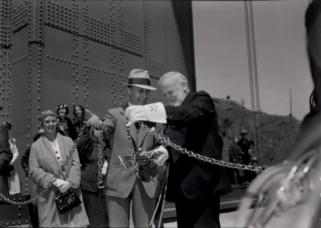10/26/2003: B1: Frank Doyle, right, president of Santa Rosa's Exchange Bank and leader of efforts to build the Golden Gate Bridge, cuts the chain and opens the bridge to automobiles with other dignitaries.