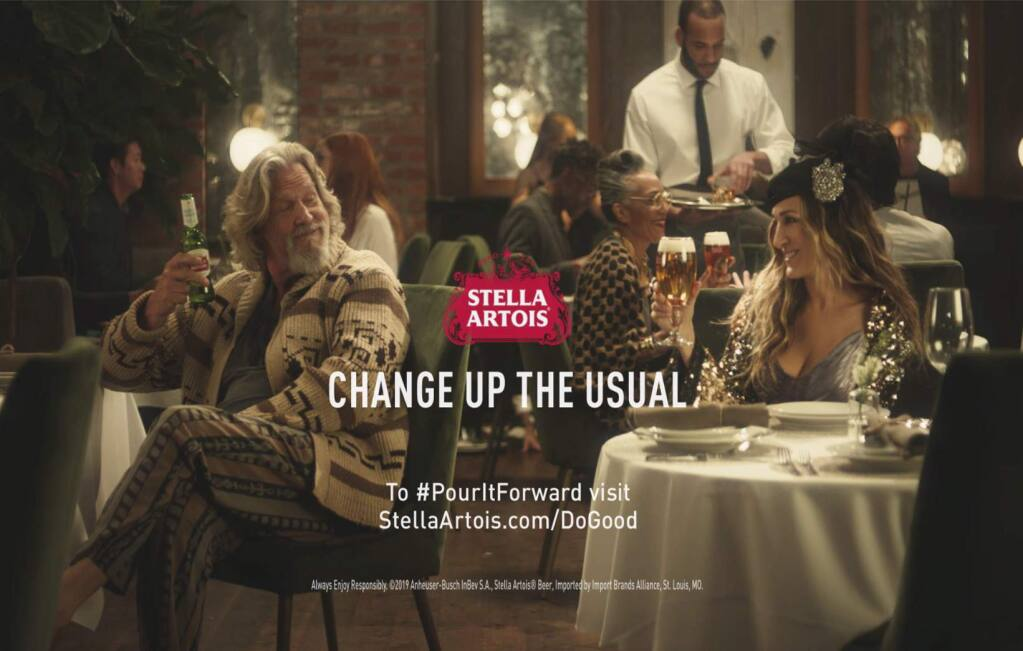 """This undated image provided by Stella Artois shows a scene from the company's Super Bowl spot with Sarah Jessica Parker, right, and Jeff Bridges. Parker will reprise her Carrie Bradshaw role from """"Sex and the City"""" and Bridges will appear as """"The Dude"""" in the Super Bowl commercial to raise money to combat water shortage. The 45-second ad launches Monday, Jan. 28, 2019, and will be televised during Super Bowl 53 on Feb. 3. (Stella Artois via AP)"""