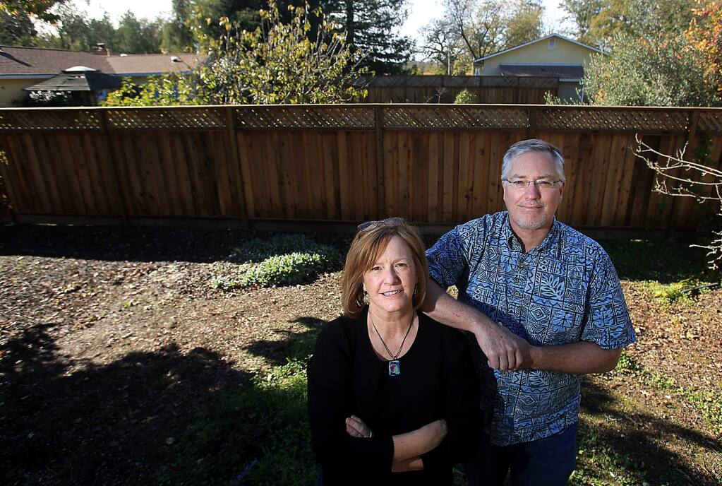 Kathleen and Michael Whitener of Santa Rosa live next door to an indoor pot grow that is ringed with tall fences, security cameras and bright outdoor lighting, Friday Dec. 1, 2016. (Kent Porter / The Press Democrat) 2016