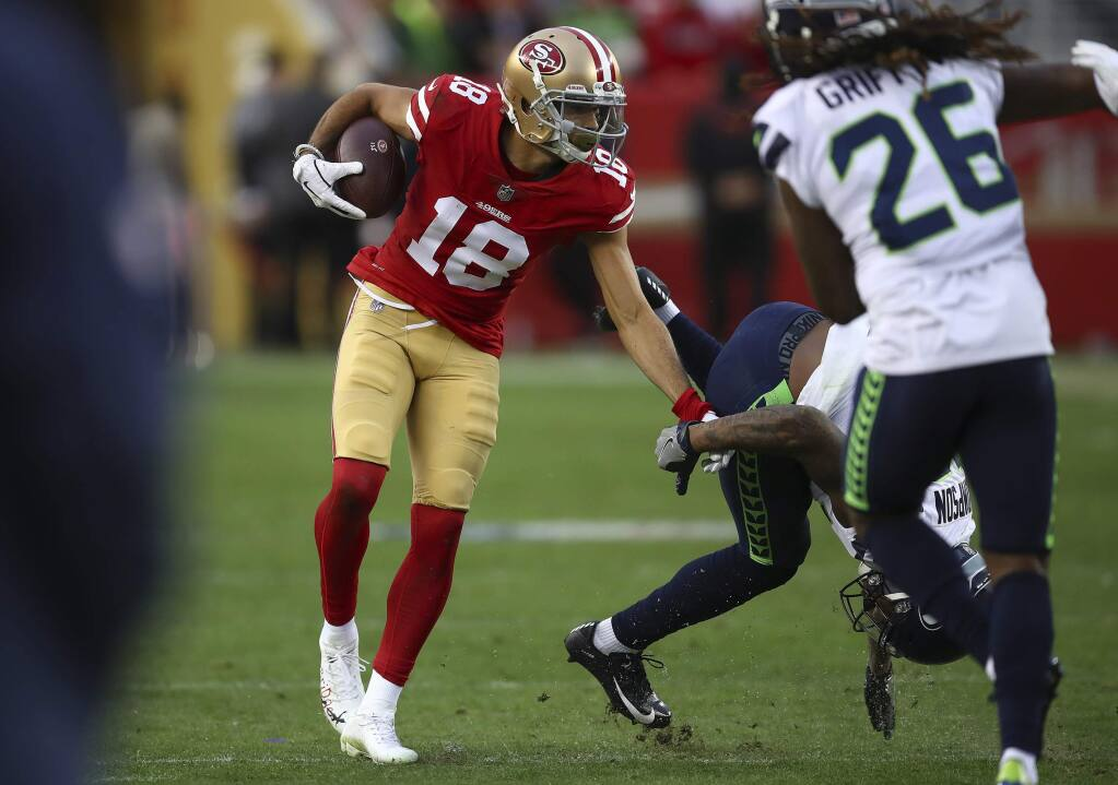 FILE - In this Dec. 16, 2018, file photo, San Francisco 49ers wide receiver Dante Pettis (18) runs against the Seattle Seahawks during the second half of an NFL football game in Santa Clara, Calif. The one benefit for Pettis during a disappointing start to his rookie season for the 49ers a year ago was that the knee injury that limited his playing time allowed him to learn the offense better. (AP Photo/Ben Margot, File)
