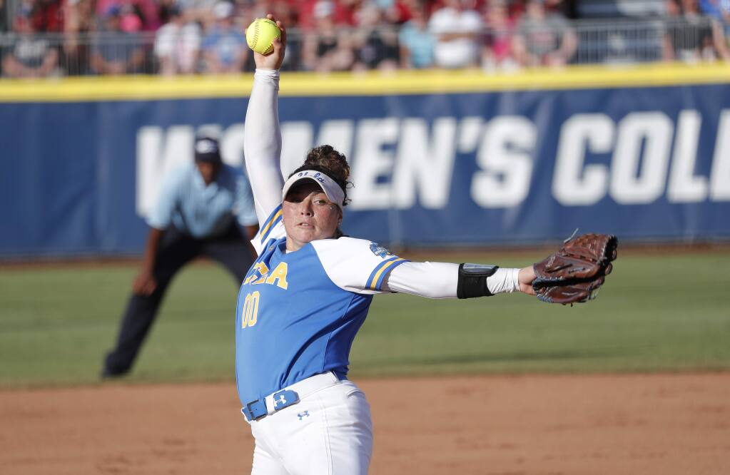 UCLA's Rachel Garcia pitches against Oklahoma in the first inning of the first game of the best-of-three championship series in the NCAA softball Women's College World Series in Oklahoma City, Monday, June 3, 2019. (AP Photo/Alonzo Adams)