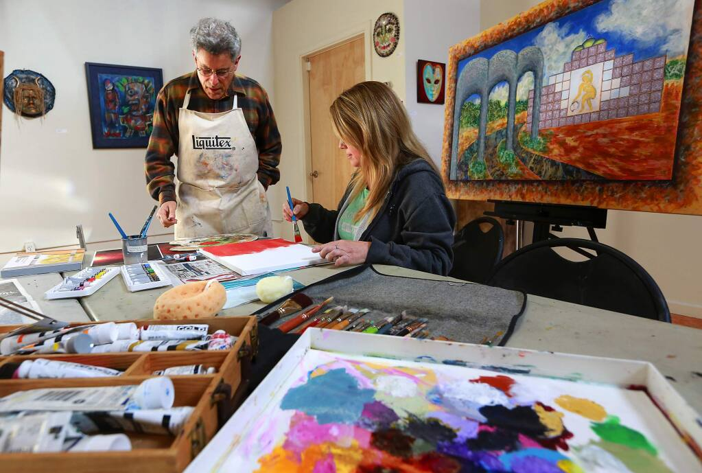 Art instructor Simmon Factor works with Toni Dufford in his beginning painting class at the Chroma Gallery in the South A Street district of Santa Rosa. (JOHN BURGESS/ PD)