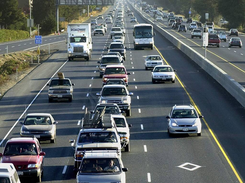 Commuter traffic on northbound Highway 101 looking south from the Hearn Avenue overpass. Transportation accounts for the largest human-caused source of carbon emissions in Sonoma County and most of the North Bay. (Press Democrat File)