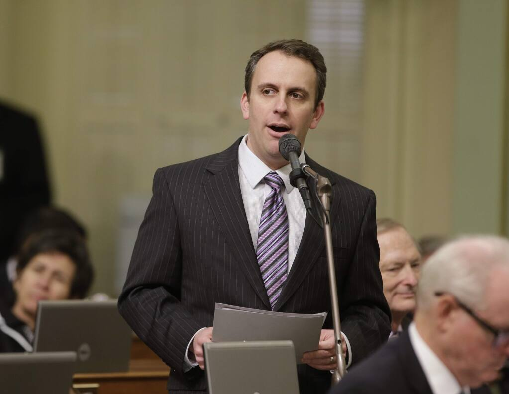 Assemblyman Marc Levine, D-San Rafael, calls on lawmakers to approve his measure to allow California voters to post photos of their marked ballot on social media during the Assembly session Wednesday, Jan. 27, 2016, in Sacramento, Calif. Levine's bill, AB144 was approved and sent to the Senate. (AP Photo/Rich Pedroncelli)