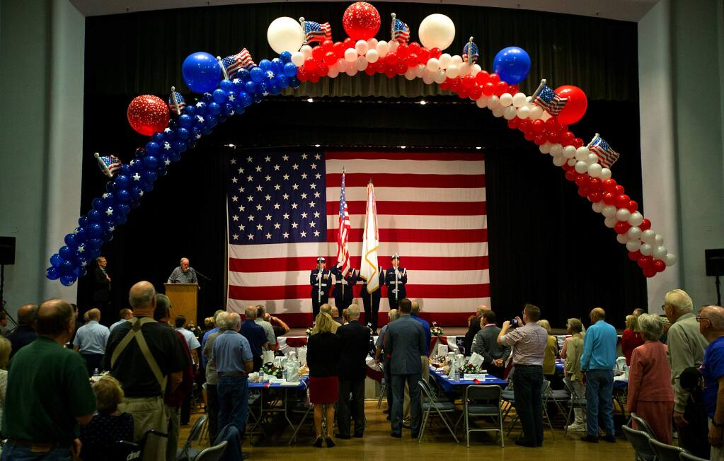 The color guard present the flag at the 16th annual Tribute to Our Veterans luncheon at the Santa Rosa Veterans Memorial hall on Wednesday. (John Burgess/The Press Democrat)