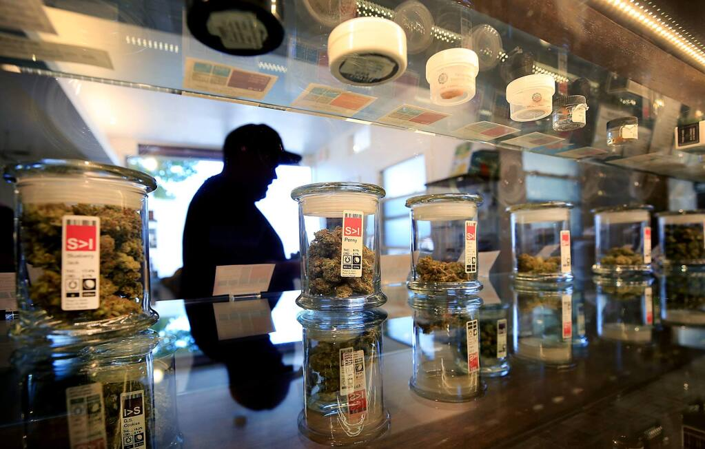 A customer leaves with his purchase at the Peace in Medicine dispensary in Santa Rosa on Monday, May 22, 2017. The dispensary is merging with SPARC, a San Francisco collective. (KENT PORTER/ PD)