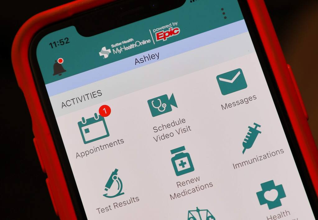 The Sutter Health smartphone app allows patients to schedule a video visit to discuss their symptoms. The use of telemedicine helps to provide care amid the pandemic and recedes the risk of community spread of the coronavirus.(Christopher Chung/ The Press Democrat)