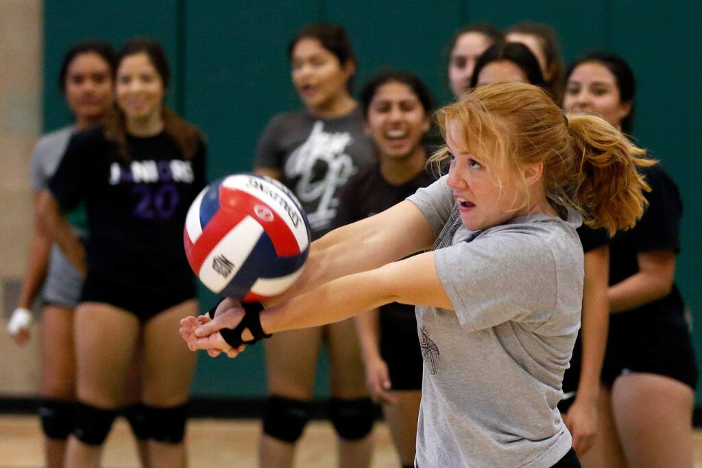 Calistoga's Kaitlyn Saunders bumps the ball as the team works on passing drills during varsity volleyball practice at Calistoga High School in Calistoga, California, on Tuesday, October 30, 2018. (Alvin Jornada / The Press Democrat)