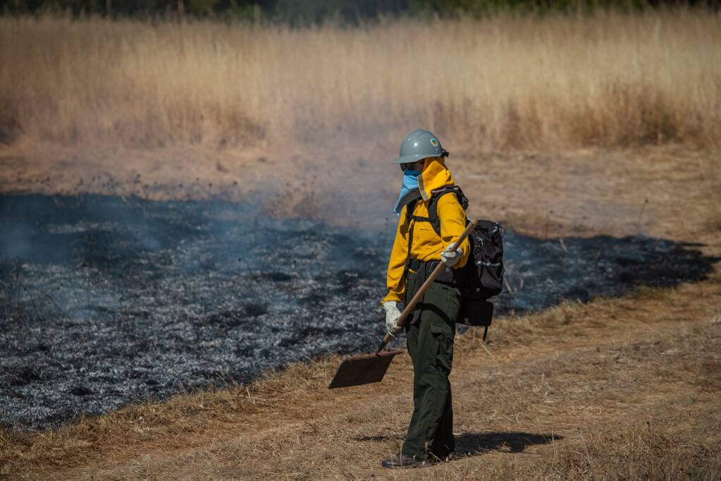 A Sonoma Valley firefighter at a prescribed burn at Van Hoosear Wildflower Preserve on Friday, June 3, 2021. (Lukas Wynne/Special to the Index-Tribune).