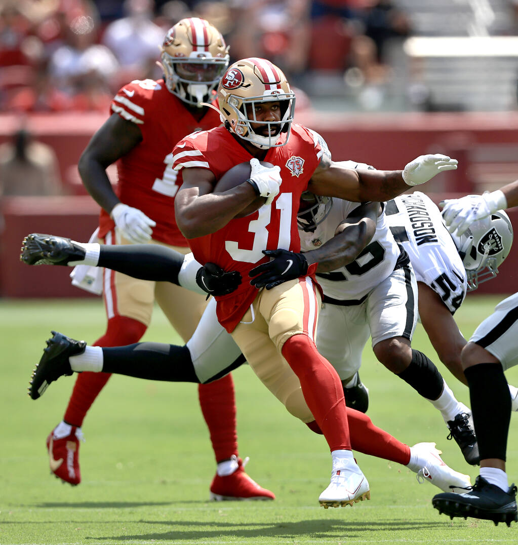 Raheem Mostert picks up a first down during the 49ers' 34-10 preseason win over the Las Vegas Raiders on Sunday. Aug. 29. (Kent Porter / The Press Democrat)