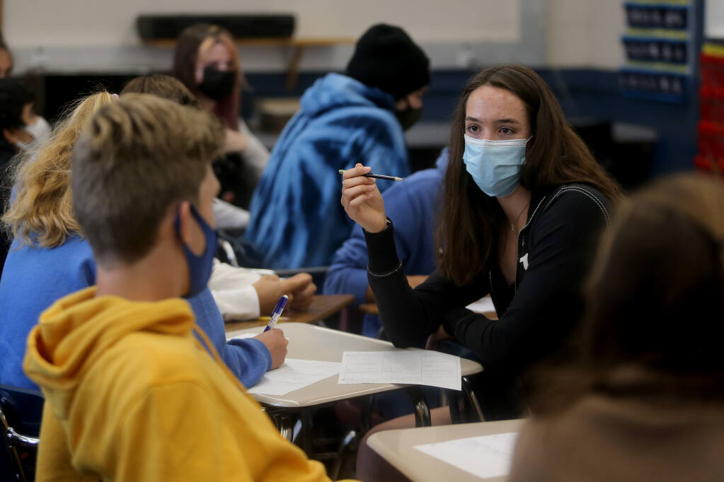 Rachel Cohen, 16, talks with classmates during triganometry class at West County High School, on the former Analy High School campus, in Sebastopol, Calif., on Thursday, Aug. 12, 2021.(Beth Schlanker/The Press Democrat)