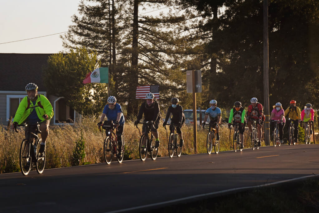 Riders heading down Todd Road during the international Ride of Silence, an event to remember fellow cyclists who have been killed or injured riding on public roadways, held in Santa Rosa, California, on Wednesday, May 19, 2021. (Erik Castro / For The Press Democrat)
