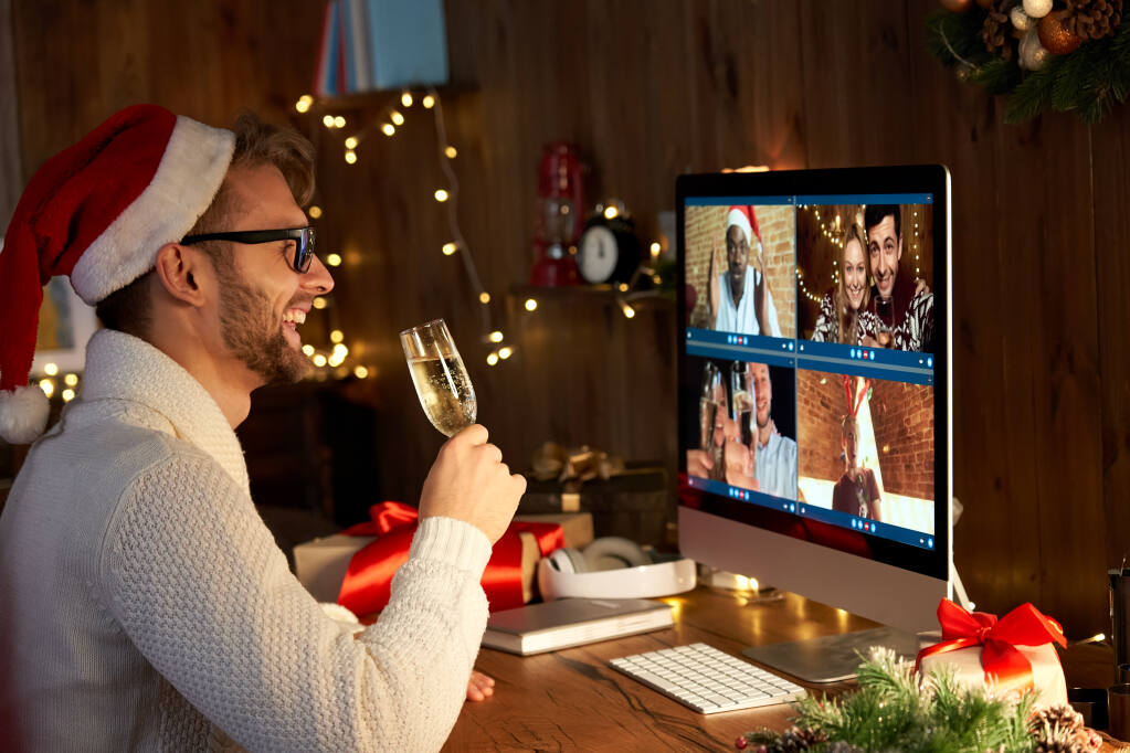 If large segments of your employees are working remotely, consider throwing a virtual holiday party. (Insta_photos / Shutterstock)