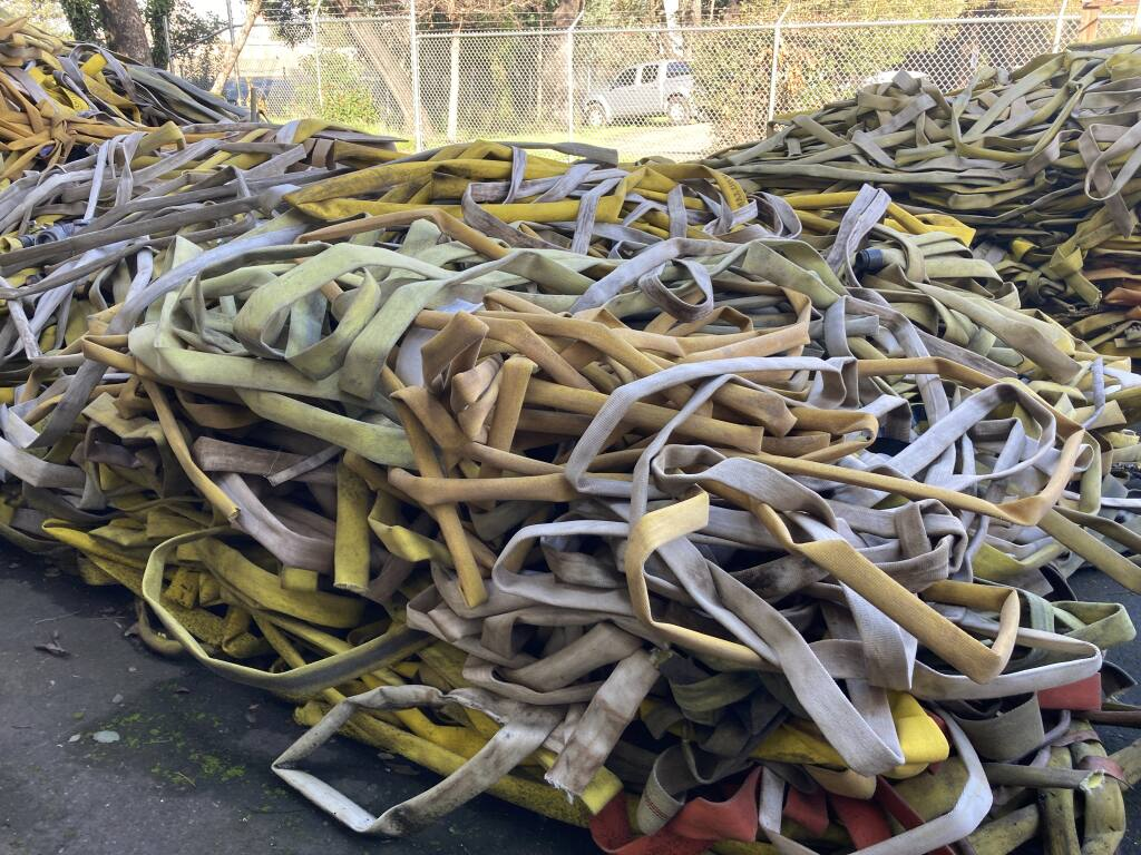 Discarded hoses — 4,700 pounds of hose from the 2020 Glass Fire and another 2,500 from the 2019 Kincade Fire — were pulled from the waste stream and some used to make products like drink coasters. (courtesy of Steffen Kuehr / TekTailor)