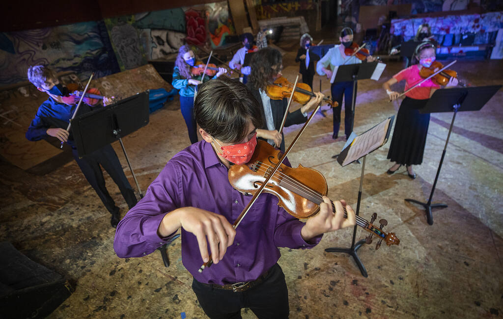 Aedan Seaver plays the Redwood Violin with the Young People's Chamber Orchestra at the Phoenix Theater on Monday, April 19, 2021. (Photo by John Burgess/The Press Democrat)