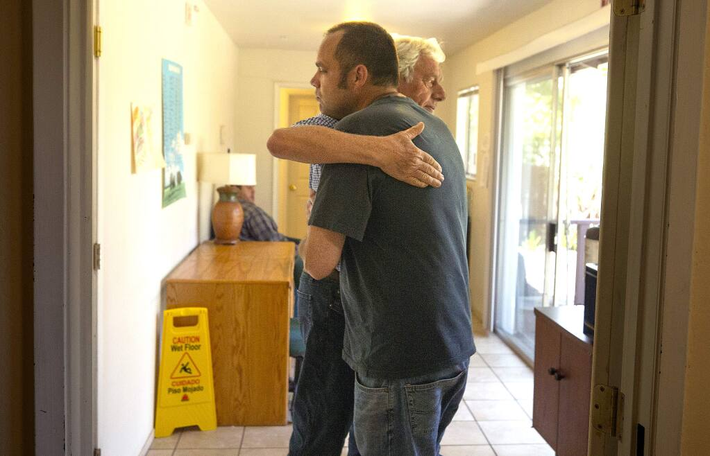 Peter Lloyd gives his son Robert a hug at the Hope House, a residential care facility for those with mental illness in Santa Rosa. Robert, who is diagnosed with schizophrenia, has learned to give hugs and function better in society after 2 years at the home. (photo by John Burgess/The Press Democrat)