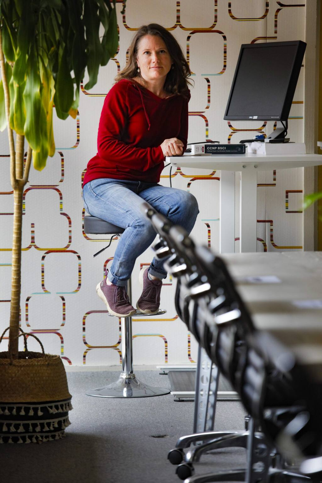 Natasha Juliana, owner of WORK Petaluma, a shared workspace in downtown Petaluma, sits in her empty office space that is usually bustling with those who work remotely. (CRISSY PASCUAL/ARGUS-COURIER STAFF)