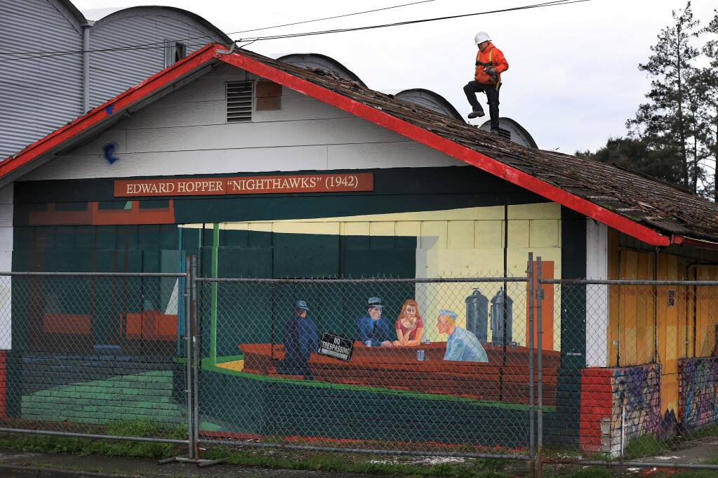 Crews are busy tearing down a building that displays local artists' work at the corner of Cleveland and College avenues in Santa Rosa on Monday, Jan. 14, 2019. (KENT PORTER/ PD)