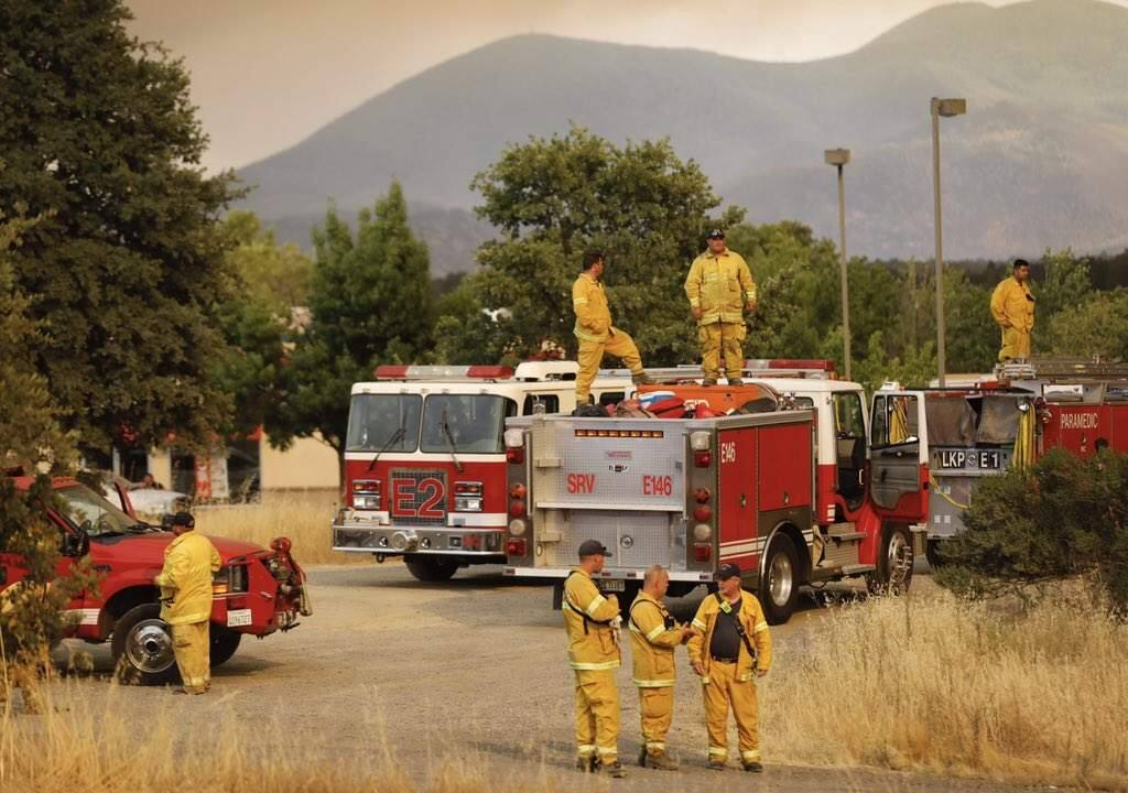 Firefighters stage in Lakeport to fight the Mendocino Complex fires on Sunday, July 29, 2018. (BETH SCHLANKER/Press Democrat)
