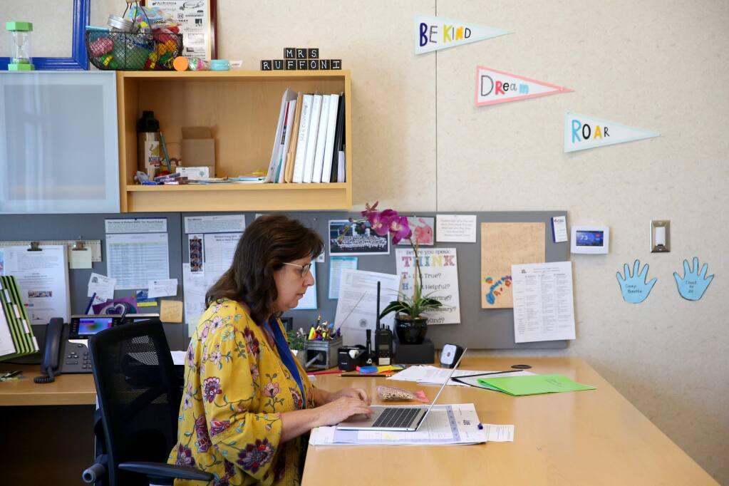 Principal Teresa Ruffoni works in her office at Richard Crane Elementary School in Rohnert Park in Rohnert Park, Calif., on Wednesday, June 10, 2020. (BETH SCHLANKER/ The Press Democrat)
