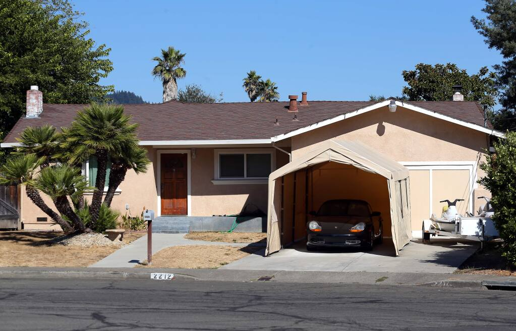 The Windsor Court home in Rincon Valley where a resident was shot during a home-invasion robbery.(Christopher Chung/ The Press Democrat)