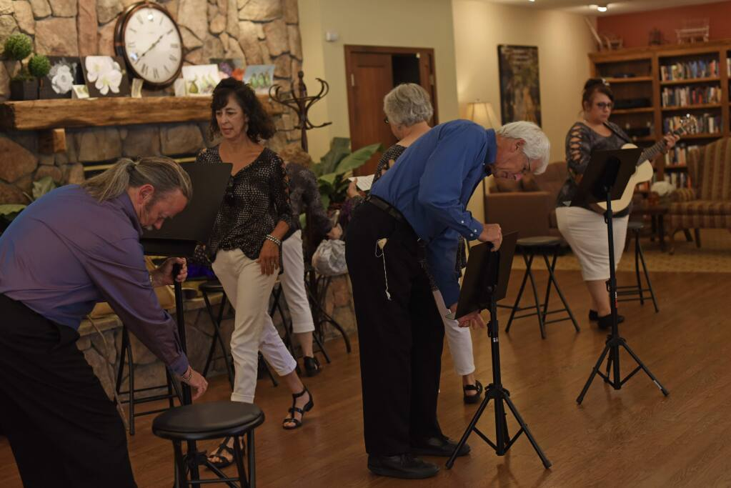 Members of the Kelly Street Cabaret setting up before a Saturday afternoon performance at Brookdale Paulin Creek, an independent and assisted living center for seniors, in Santa Rosa, California. August 10, 2019.(Photo: Erik Castro/for The Press Democrat)