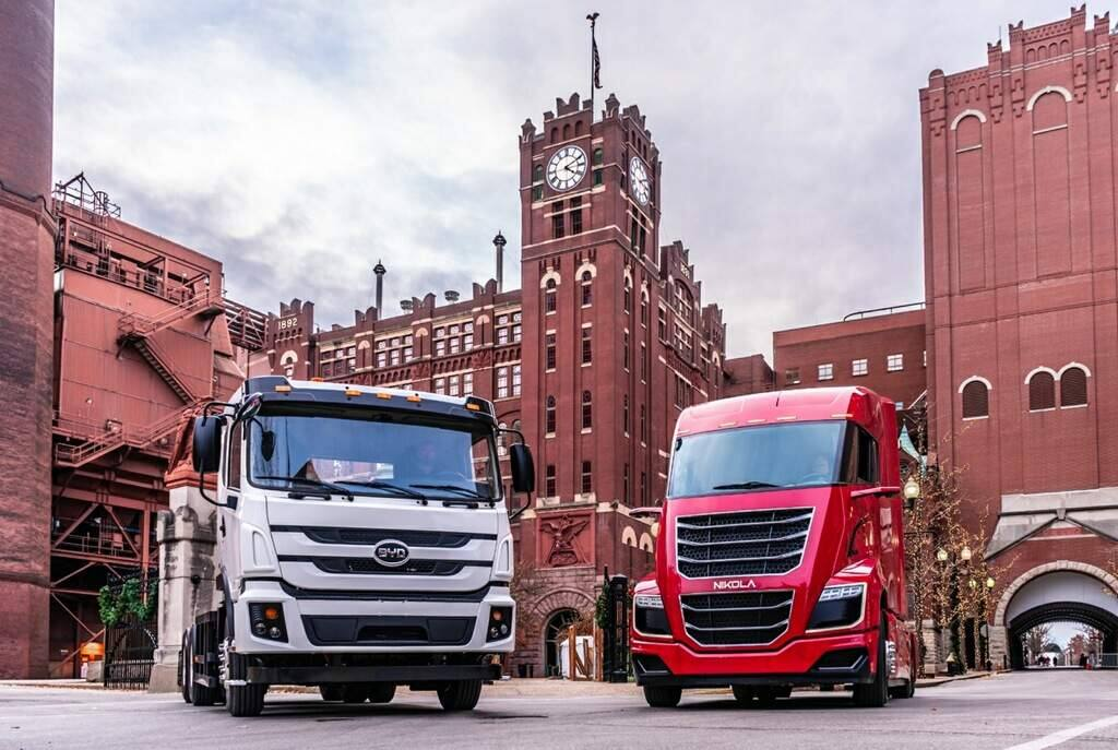 Anheuser-Busch in November 2019 demonstrated Nikola Motors' fuel-cell truck, left, and BYD Motors' electric truck at its Budweiser brewery in St. Louis. The beverage company has ordered hundreds of the vehicles. (courtesy of Anheuser-Busch)