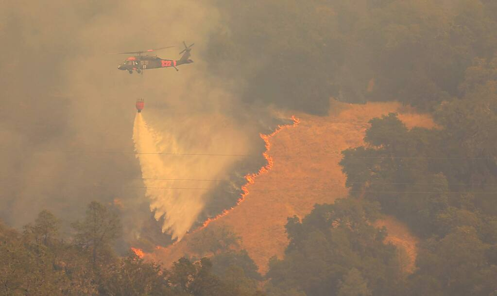 The Air National Guard makes a drop on the Pocket fire in Geyserville, Thursday Oct. 12, 2017. (Kent Porter / Press Democrat) 2017