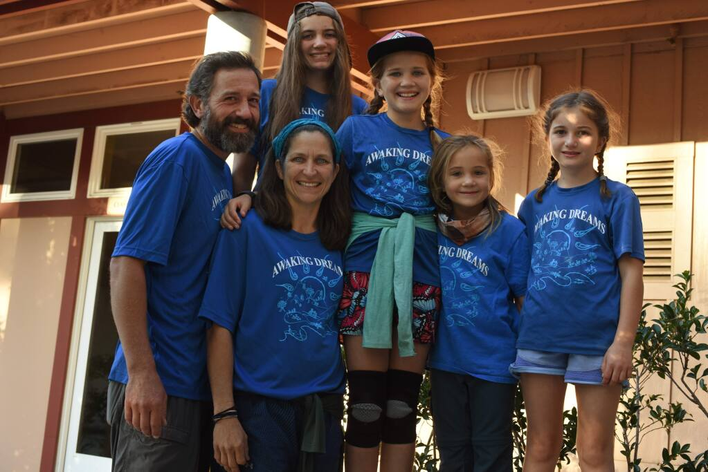 Chris and Jamie Malone with their four daughters, from left, Maya, 12, Harper, 10, Sabina, 6, and Josie, 8, during an evening presentation about the family's 164-day, 2,200 mile hiking adventure through the entire Appalachian Trail held Friday at Community Church of Sebastopol United Church of Christ in Sebastopol, California. September 27, 2019.(Photo: Erik Castro/for The Press Democrat)